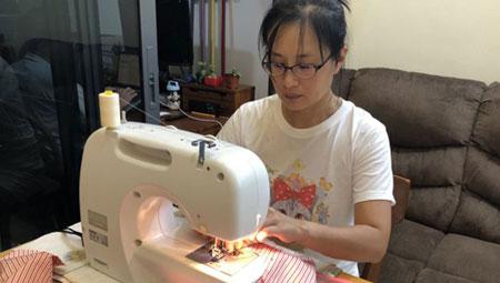 Coronavirus: Volunteers team up to make masks at home, stitch by stitch