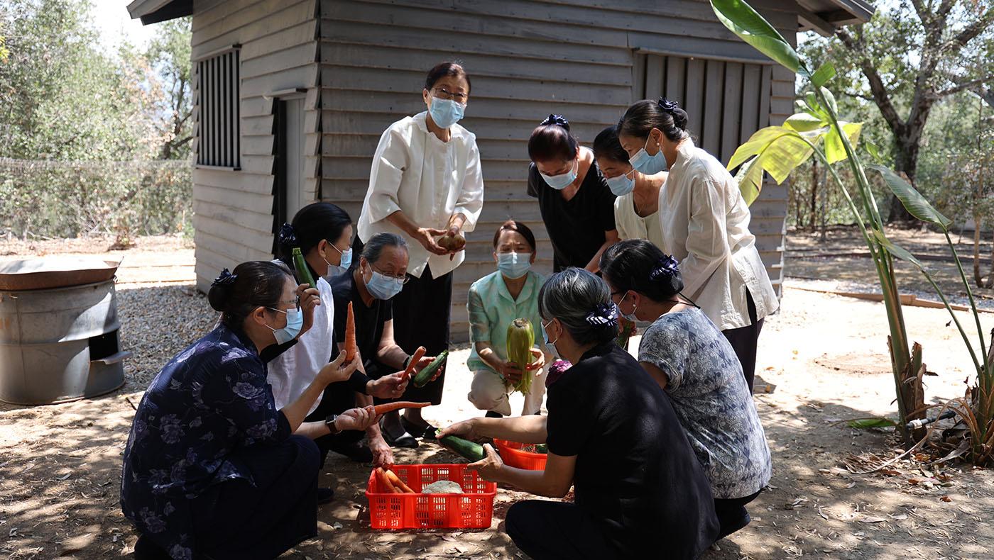 Volunteers record a scene near the small cabin at Tzu Chi USA's National Headquarters introducing Tzu Chi's origins. Photo/Shuli Lo