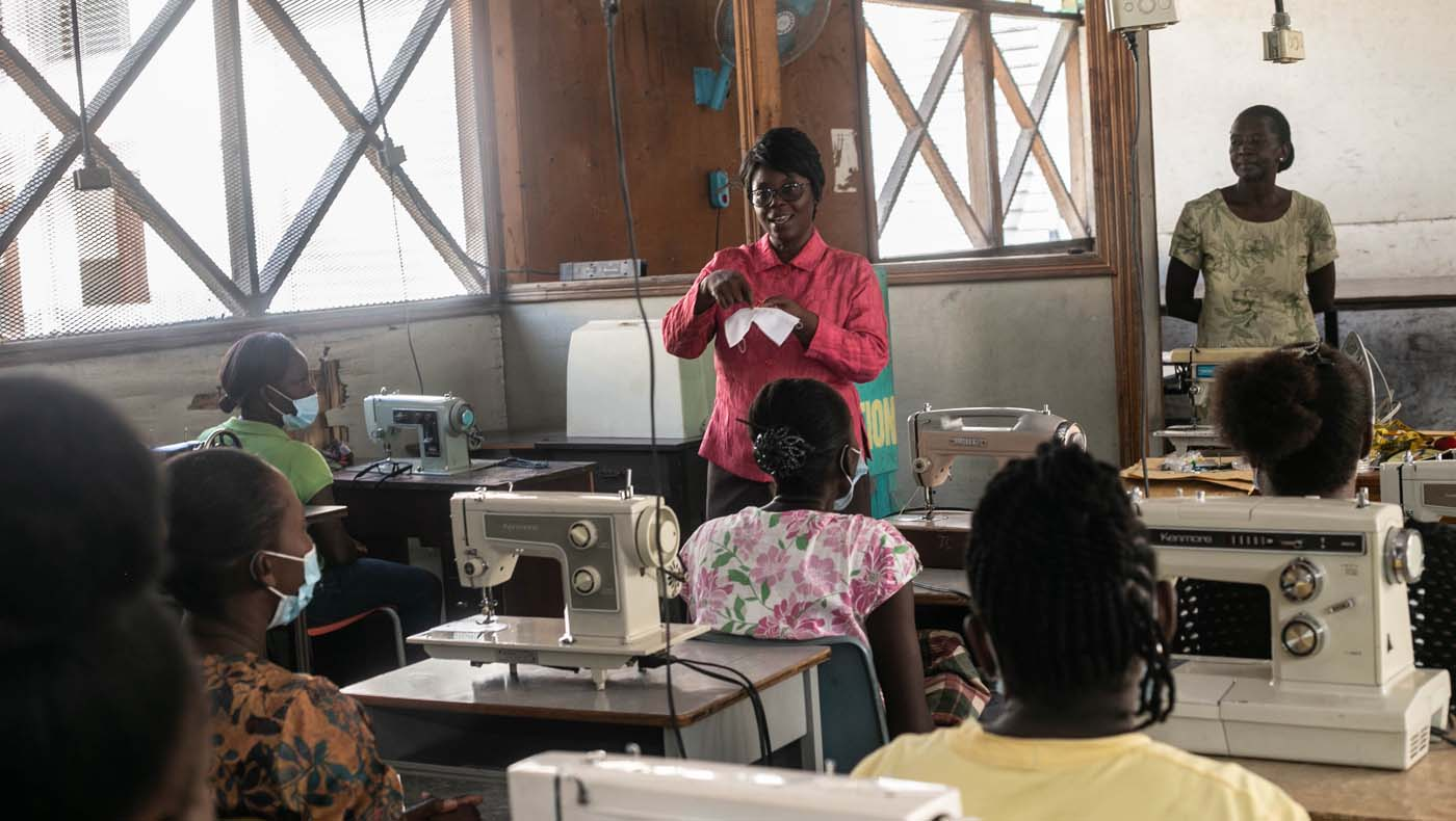 Molila Pierre teaches how to make cloth masks, the finished product to be donated to Haitian school teachers and students to strengthen pandemic prevention measures. Photo/Keziah Jean
